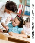 young teacher helps pupils to...   Shutterstock . vector #112394210