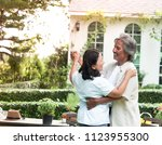 senior couple laughing together ... | Shutterstock . vector #1123955300