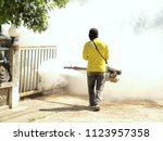 guys are spraying fumes in the... | Shutterstock . vector #1123957358