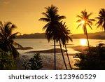 sunset over the tropical beach... | Shutterstock . vector #1123960529