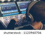 little dj adjusting sound... | Shutterstock . vector #1123960706