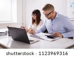 two young businesspeople... | Shutterstock . vector #1123969316
