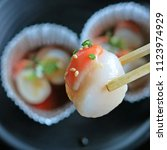 fresh raw scallop with white...