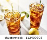 Cold Iced Tea With Straws And...