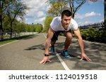 athletic man is bending to... | Shutterstock . vector #1124019518