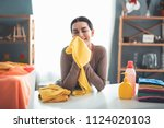 satisfied brunette lady... | Shutterstock . vector #1124020103