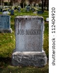 Gravestone In Cemetery For Job...