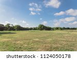 beautiful green urban park in... | Shutterstock . vector #1124050178