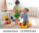 a boy and a girl are holding a... | Shutterstock . vector #1124053163