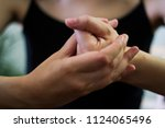 woman cracking their knuckles ... | Shutterstock . vector #1124065496