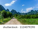 beautiful karst mountains are... | Shutterstock . vector #1124079290