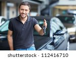 young man with the keys at the... | Shutterstock . vector #112416710