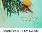 jewish festival of sukkot.... | Shutterstock . vector #1124168483