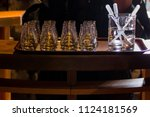 tray with rows of glasses and... | Shutterstock . vector #1124181569