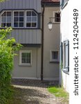 alley in south germany city... | Shutterstock . vector #1124204489