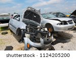 A Junked Car Collapsed Onto...