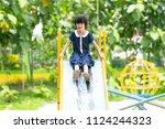 asian happy kid playing slider... | Shutterstock . vector #1124244323