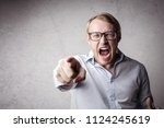 angry man screaming  | Shutterstock . vector #1124245619
