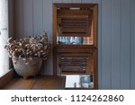 antique vase with dry flower. | Shutterstock . vector #1124262860