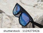 sun glasses on the beach   Shutterstock . vector #1124273426