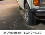 old flat tire tires safety...   Shutterstock . vector #1124274110