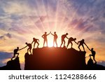 Silhouette Of Climbers Who...
