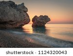 beautiful sunrise over pebble... | Shutterstock . vector #1124320043
