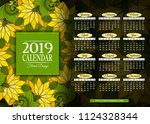 colored 2019 year calendar... | Shutterstock .eps vector #1124328344