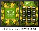 colored 2019 year calendar... | Shutterstock .eps vector #1124328368