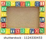 alphabet blocks on board. copy... | Shutterstock . vector #1124330453