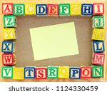 alphabet blocks on board with... | Shutterstock . vector #1124330459