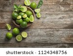 Bowl With Fresh Ripe Limes On...
