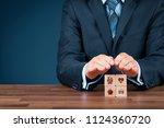 insurance concept. businessman... | Shutterstock . vector #1124360720