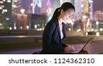 businesswoman typing on...   Shutterstock . vector #1124362310