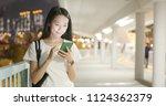 woman look at smart phone in...   Shutterstock . vector #1124362379
