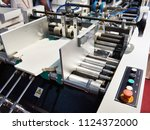 machine for the production of... | Shutterstock . vector #1124372000