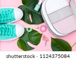 bright summer accessories on a... | Shutterstock . vector #1124375084