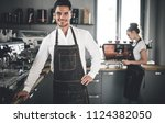 professional barista in apron... | Shutterstock . vector #1124382050