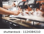coffee machine standing at the... | Shutterstock . vector #1124384210