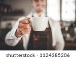 barista presents cup of hot... | Shutterstock . vector #1124385206