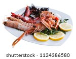 delicious prawns  langoustines... | Shutterstock . vector #1124386580