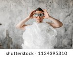 mad freak man weared in... | Shutterstock . vector #1124395310