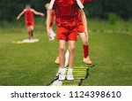 young athletes training with... | Shutterstock . vector #1124398610