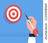 human hand holding arrow hit... | Shutterstock .eps vector #1124408069