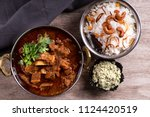 spicy and delicious beef curry... | Shutterstock . vector #1124420519