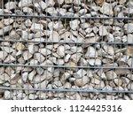 stone gabion wall. gabion  ... | Shutterstock . vector #1124425316