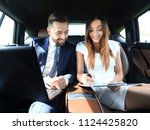 man and woman discussing work... | Shutterstock . vector #1124425820
