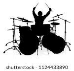A Drummer Musician Drumming...