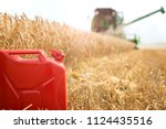 gas can in the wheat field... | Shutterstock . vector #1124435516