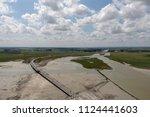 river and ocean in mt. st.... | Shutterstock . vector #1124441603